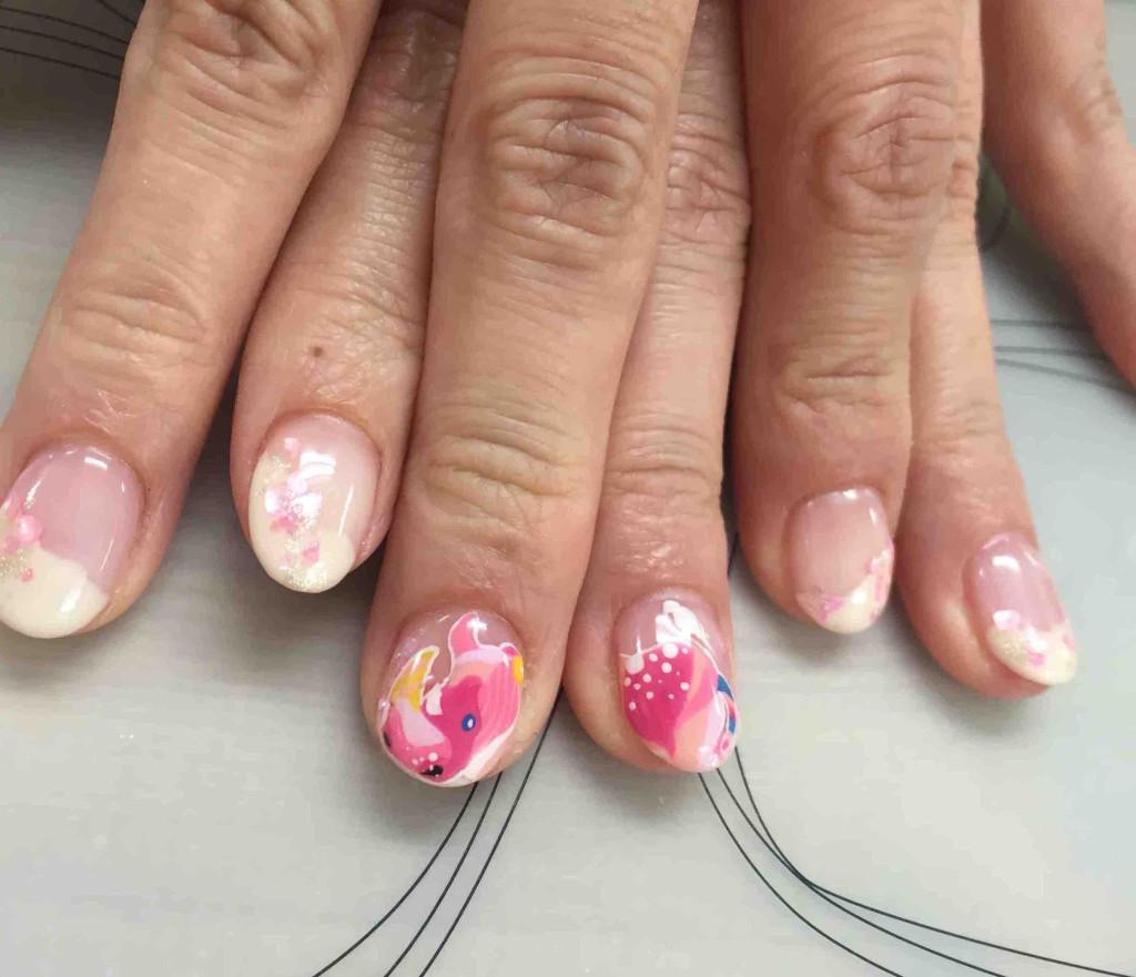 ピンクのサイの桜ネイル
